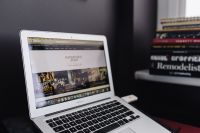Macbook Air laptop on the pink desk