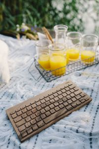 Wooden keyboard on the white blanket