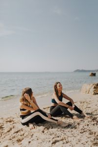 Kaboompics - Women sitting on the beach