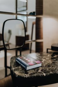 Kaboompics - Book on a marble table