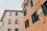 Pastel pink building with turquoise shutters, Rovinj, Croatia