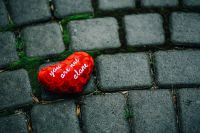 Kaboompics - Small red heart on a cobblestone path