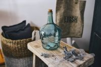Kaboompics - Cyan decorational bottle on a wooden stool