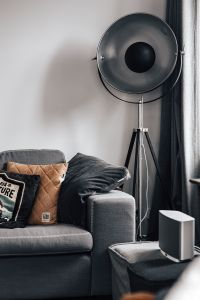 Kaboompics - Grey couch, pillows, floor lamp
