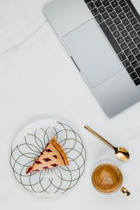 Kaboompics - Fresh baked blueberry pie, cup of coffee & laptop