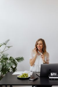 Kaboompics - A businesswoman speaks on the phone at her desk