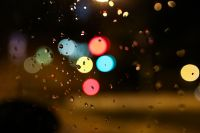 Kaboompics - Colourful city lights through a wet car window