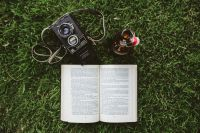 Kaboompics - Book on the grass with a vintage camera