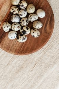 Quail eggs on wooden plate