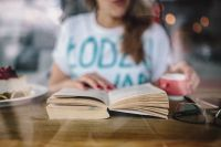 Kaboompics - Woman reading book at coffee shop