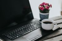 Kaboompics - Little pink flowers with a coffee and a black laptop