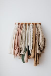Kaboompics - Sweaters on a hanger