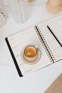 Kaboompics - Coffee & Weekly Planner on Marble