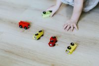 Kaboompics - Child playing with wooden cars