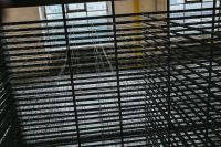 Kaboompics - A view through the grating in an abandoned building hall