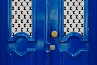 Kaboompics - Colorful wooden door in the facade of a typical Portuguese house at Lisbon, Portugal