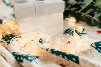 Kaboompics - White decorative gift box and Christmas lights on a blanket