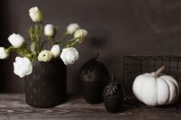 Kaboompics - Dark mood home decorations with pumpkin & flowers
