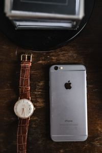 Kaboompics - Apple iPhone 6 and Vintage watch on a brown leather wallet