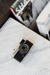 Kaboompics - Old camera on marble - top view