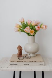 Kaboompics - Tulip flowers - candle - book - glasses