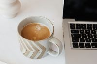 Kaboompics - Laptop & cup of coffee on marble table