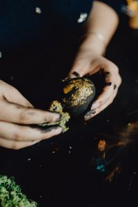Kaboompics - Woman Painting Black & Gold Easter Eggs