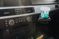 Kaboompics - Car ventilation system and air conditioning with coffee in handle, BMW E91 320d