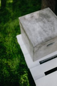 Kaboompics - Concrete side table and green grass in garden