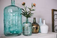 Kaboompics - Jugs and flowers on a wardrobe