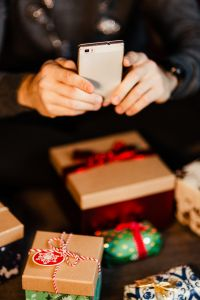 Kaboompics - A handsome man with Christmas presents - using mobile phone