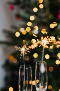 Kaboompics - New Year's Eve - champagne glasses on a Christmas tree background