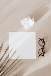 Kaboompics - Blank card & glasses on beige background