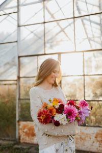 Kaboompics - A woman with beautiful colorful dahlia flowers