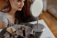 Kaboompics - Young beautiful woman doing her make up