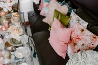Kaboompics - Porcelain, glass dishware on the glass table and pillows