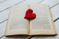 Kaboompics - Little red heart with an old book