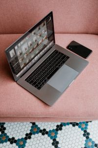 Kaboompics - MacBook Pro laptop & iPhone X mobile on a pink sofa