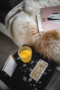 Kaboompics - Bedside table, iPhone mobile, Kinfolk magazine and cup of orange juice
