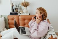 Kaboompics - Woman uses laptop - working from home - talking on the mobile phone