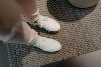 Kaboompics - A woman in white flatform sneakers