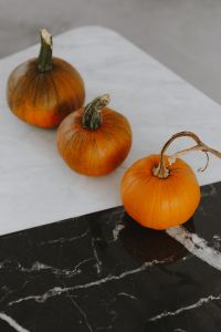 Kaboompics - Orange halloween pumpkins on marble
