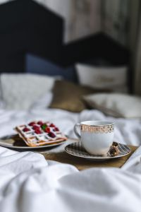 Kaboompics - Breakfast in bed - waffles with raspberries and cup of coffee on the tray