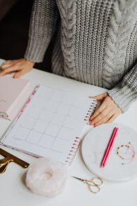 A woman writes in a calendar