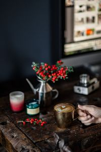 Kaboompics - Cup of coffee, Fresh Holly and Candles