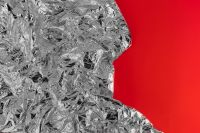 Kaboompics - Silver Foil Texture & Red Background
