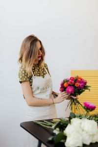 Kaboompics - A beautiful woman florist makes a bouquet