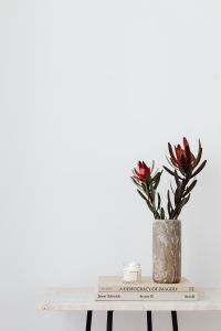 Kaboompics - LEUCADENDRON SAFARI SUNSET - dried flower - candle - marble vase - glasses