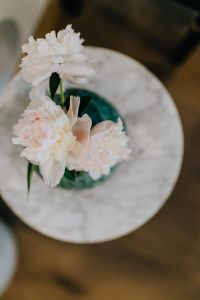 Kaboompics - Peony flowers in vase on marble table