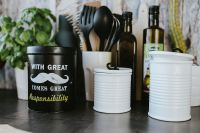 Kaboompics - Kitchen utensils and cans by the wall